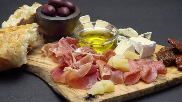 Thumbnail for Sliced Prosciutto, Cheese and Salami Sausage on a Wooden Board