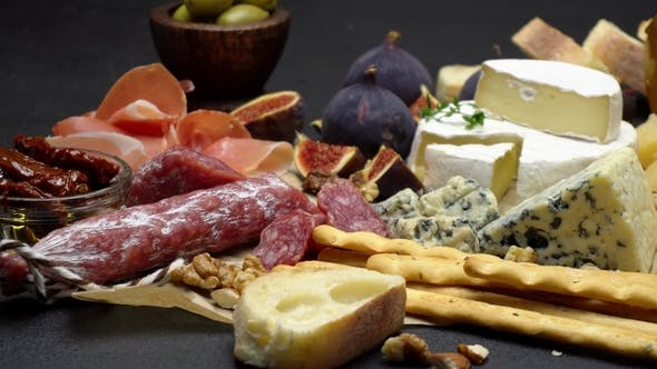 Thumbnail for Video of Various Types of Cheese and Sausage - Parmesan, Brie, Roquefort
