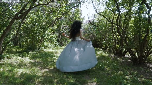 Cover Image for Beautiful Woman Holding Apple in Hand Run Through a Garden, Snow White Fairytale