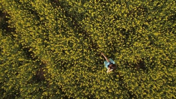 Thumbnail for Beautiful Woman Walks Among Yellow Flowers