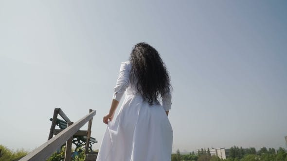 Thumbnail for Woman in White Dress Reach the Peak and Raise Up Hands Like a Winner