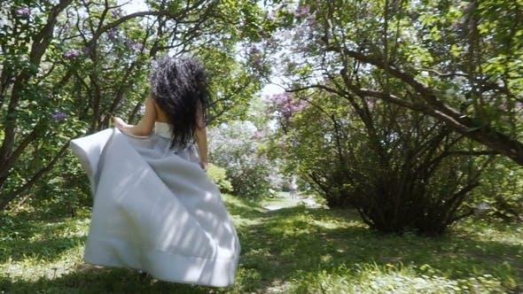 Thumbnail for Gorgeous Woman Run Through a Garden in