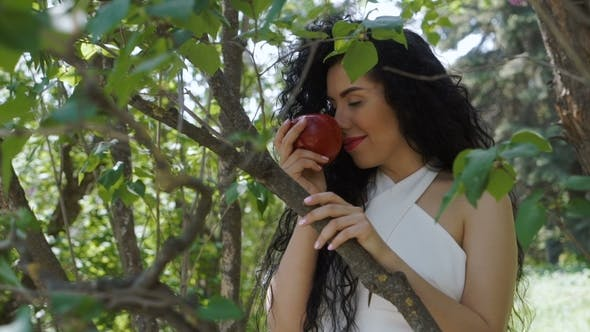 Thumbnail for Charming Woman with Red Apple Enjoy a Smell of Fruit and Smiles To Camera