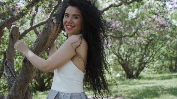 Thumbnail for Happy Brunette Posing for Camera in Summer Garden