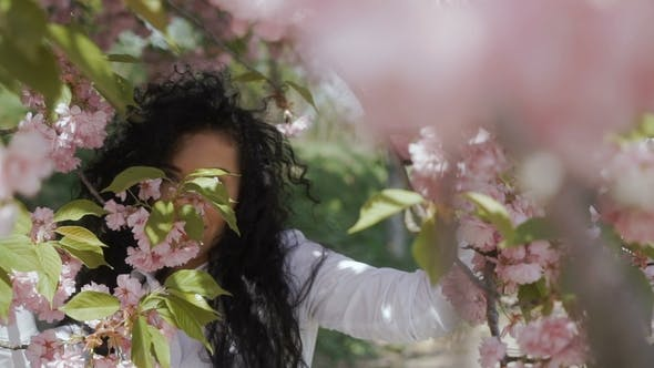 Thumbnail for Young Beautiful Woman Among Pink Flowers