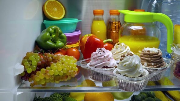 Thumbnail for Sweet Cakes in the Open Refrigerator.