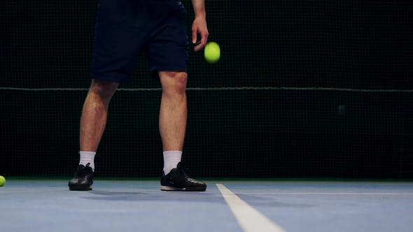 Thumbnail for Tennis Player Holding the Ball and Getting Ready to Serve
