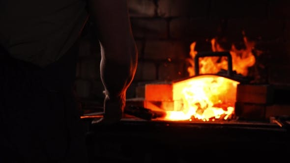 Thumbnail for Blacksmith's Hammer on the Background of Burning Flames of the Furnace