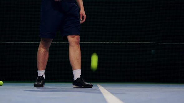 Cover Image for Tennis Player Holding the Ball and Getting Ready to Serve