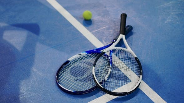 Thumbnail for Tennis Ball and Racket on a Blue Court with Room for Copy