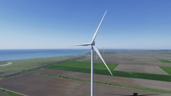 Thumbnail for Aerial View Looking Across Wind Turbines in Motion on a Summers Day