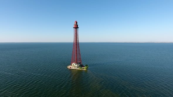 Aerial Shot of a High Red Beacon on the Black Sea Shoal in Ukraine in Summer