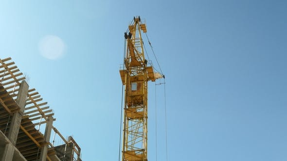 Thumbnail for Construction Crane Working by Tower Building