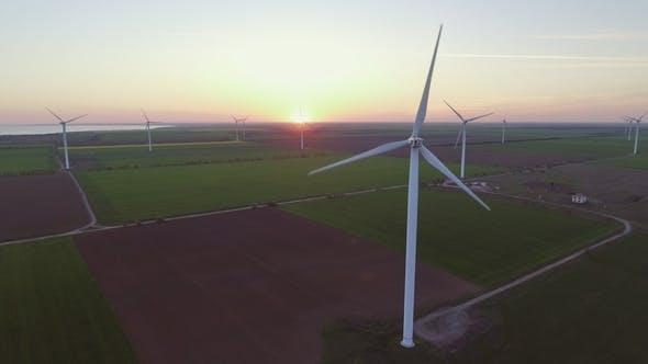 Thumbnail for Wind Turbine Power Generators Silhouettes at Sea Coastline at Sunset. Alternative Renewable Energy