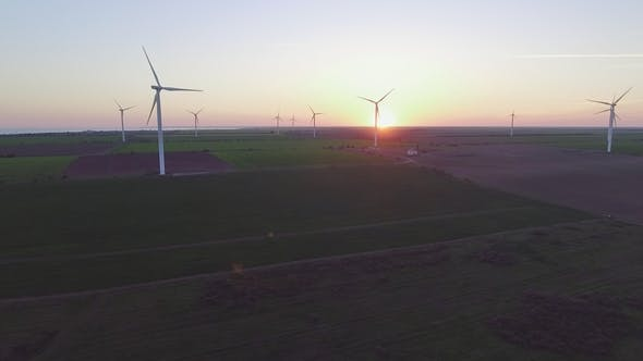 Thumbnail for Wind Turbine Power Generators Silhouettes at Sea Coastline at Sunset