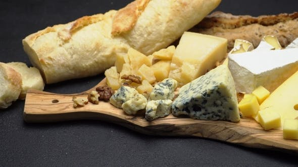 Thumbnail for Various Types of Cheese - Brie, Camembert, Roquefort and Cheddar