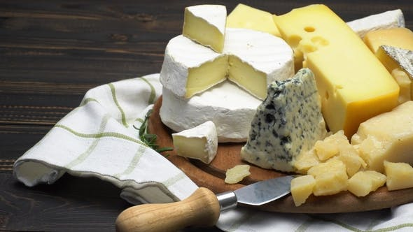 Thumbnail for Video of Various Types of Cheese - Parmesan, Brie, Cheddar and Roquefort