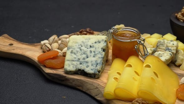 Cover Image for Video of Various Types of Cheese - Parmesan, Brie, Cheddar and Roquefort