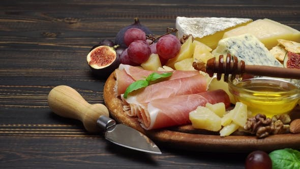 Thumbnail for Sliced Prosciutto or Jamon Meat and Cheese on Concrete Background