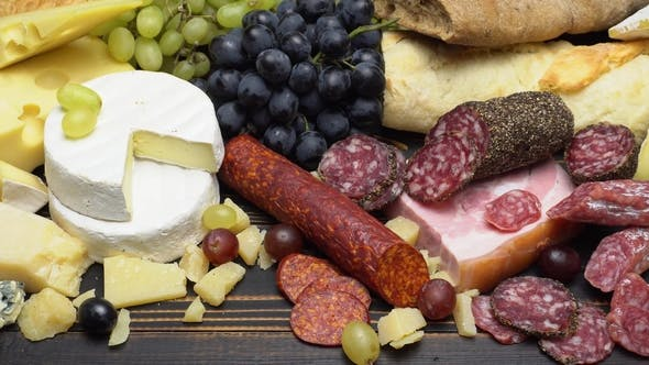 Cover Image for Video of Various Types of Cheese and Sausage - Parmesan, Brie, Roquefort