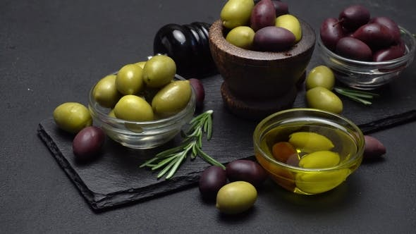 Thumbnail for Black and Green Olives and Oil on Stone Serving Board