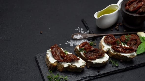 Thumbnail for Bruschetta with Canned Sundried or Dried Tomato Halves on Stone Serving Board