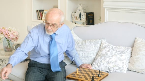 Thumbnail for Elderly Grandmaster Plays Chess Alone, Old Man Playing Chess
