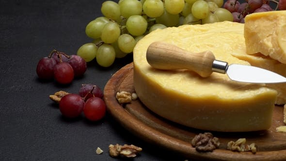 Cover Image for Whole Round Head of Parmesan Cheese, Wine and Grapes