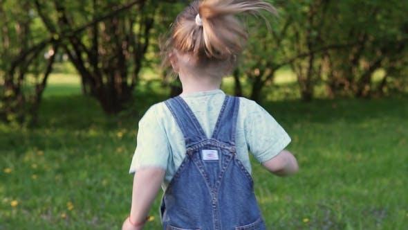 Thumbnail for Little Girl Runs Along Grass, Back View
