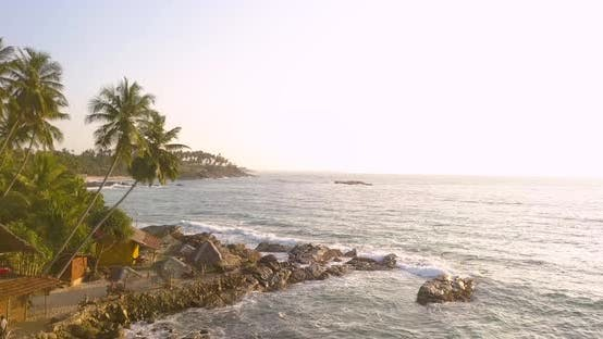 Thumbnail for Flying Over a Tropical Beach at Sunrise