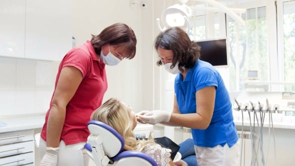 Thumbnail for Video of Dentist Preparing Patient for Teeth Whitening Procedure