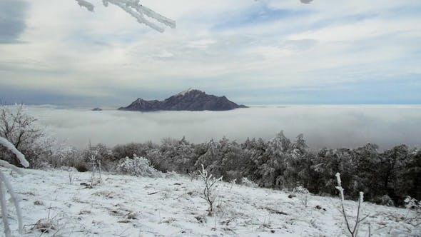of Cloud Mass Flow Through a Wide Mountain Valley