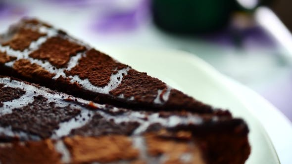 Thumbnail for Sliced Tasty Chocolate Cake on Table Background