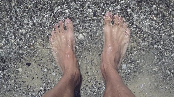 Thumbnail for Male Feet on the Beach at Seaside
