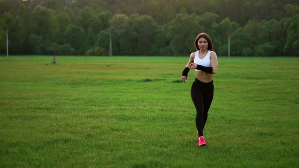 Cover Image for Girl Runs across the Field in a White Top and Black Tights