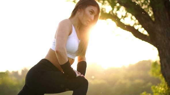 Thumbnail for Slim Athletic Woman Working out in Park Doing Knee-bounce Exercise or Lunges