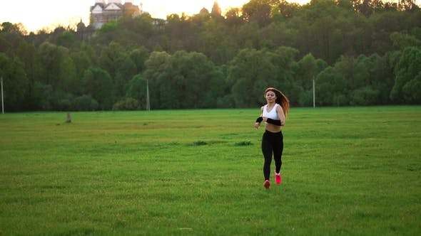 Thumbnail for Girl Runs across the Field in a White Top and Black Tights