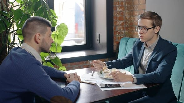 Thumbnail for Male Business Partners Having Lunch in Cafe and Talking