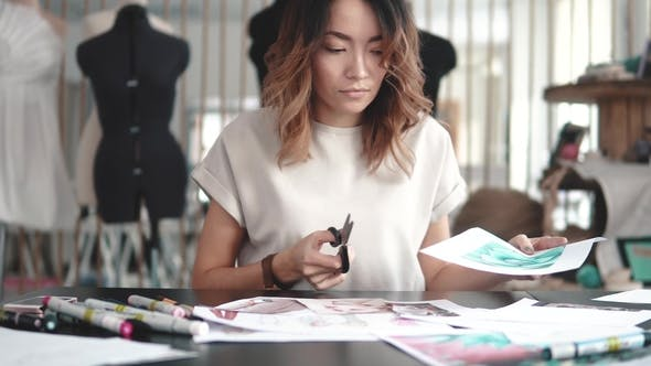 Thumbnail for Fashion Designer Makes a Collage of Drawings. Girl Designer Clothes Makes Sketches on Paper. Young