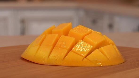 Thumbnail for Sliced Mango Fruit. Rotating Camera with White Kitchen on the Background