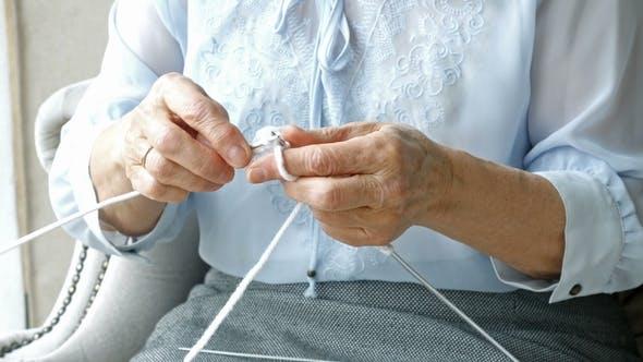 Thumbnail for Hands of Elderly Woman Knitting