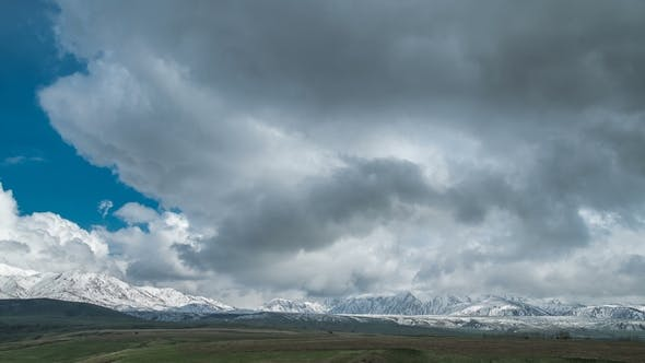 Thumbnail for Blue Sky with Clouds Over the Snow-capped Mountain Peaks in Kazakhstan.