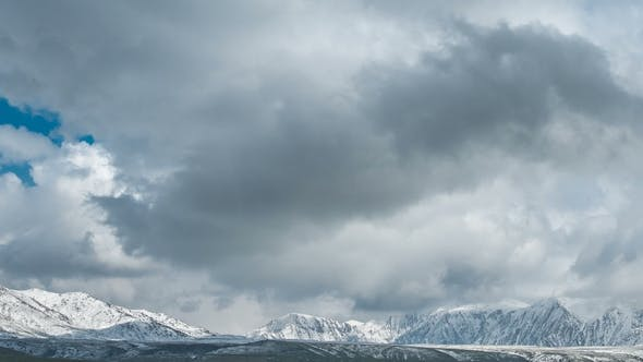 Thumbnail for Fog and Clouds Over the Snowy Peaks of the Mountains in Kazakhstan.