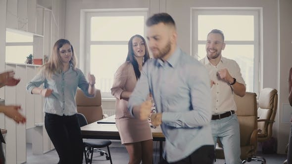 Thumbnail for Young European Businessman Dancing Together with Colleagues at Fun Casual Office Party, Celebrating