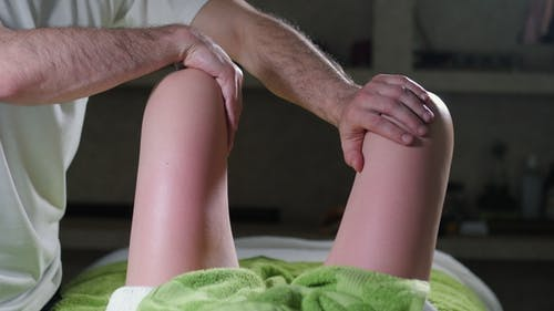 Сlose Up View of Osteopath Applying Pressure with Thumb on Female Legs Muscles. Anti Cellulite