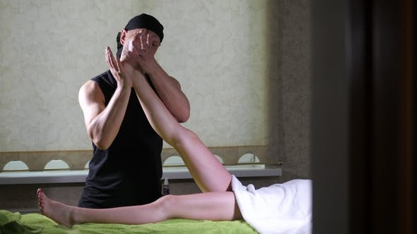 Thumbnail for Professional Male Masseuse Massaging Foot of Girl