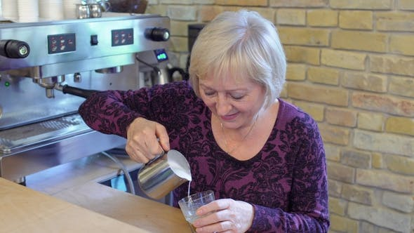 Thumbnail for Granny-barista Make Cappuccino in Cafe