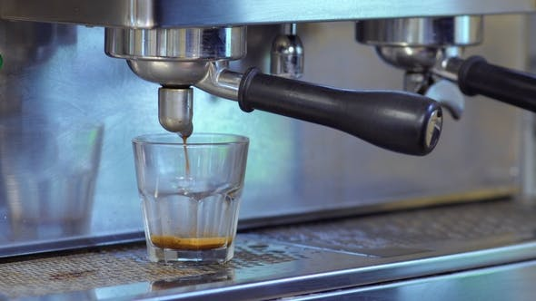 Thumbnail for Coffee Pour Into a Glass From Coffee Machine