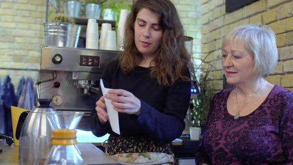 Thumbnail for Barista Tells Mature Woman About Coffee Filters and How To Use It