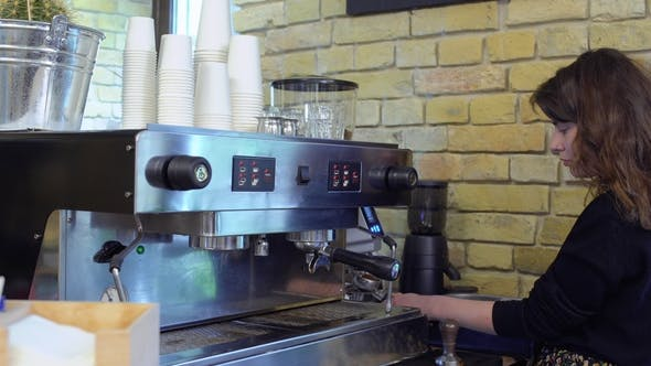 Thumbnail for Barista Tramping Grinded Coffee Inside of Portafilter